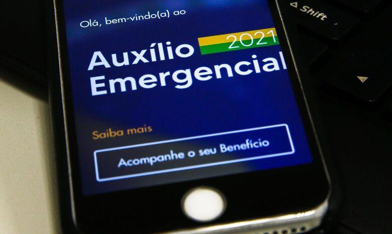 Caixa paga 3ª parcela do auxílio para nascidos em fevereiro e março - Crédito: Marcello Casal jr/Agência Brasil Economia