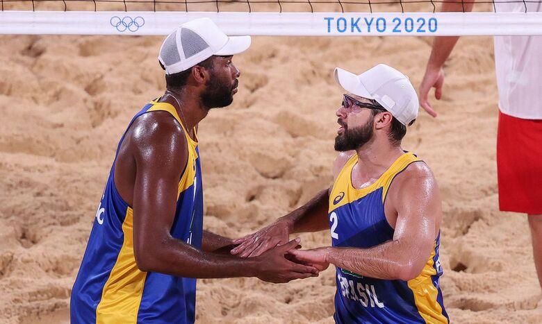 Evandro e Bruno Schmidt avançam às oitavas no vôlei de praia - Crédito: Wander Roberto/COB