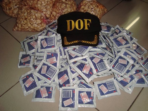 Droga era transportada em pacotes de fermento e pipoca   - Crédito: Foto: DOF