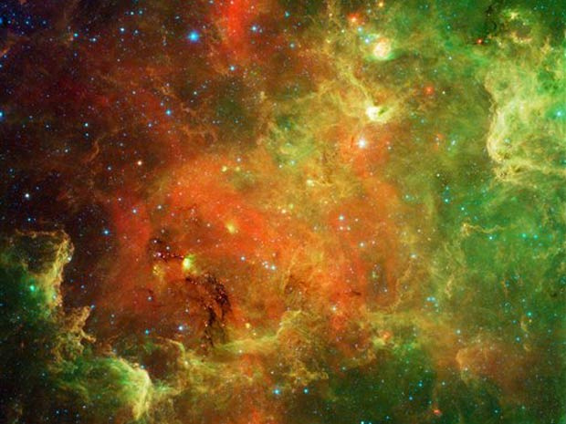Imagem feita pelo telescópio Spitzer e cedida pela Nasa mostra um grupo de estrelas conhecido como Nebulosa Norte-americana, por causa da semelhança com o mapa do continente. Este formato é causado por nuvens de poeira obstruindo a luz. - Crédito: Foto: Nasa / ASSOCIATED PRESSAP