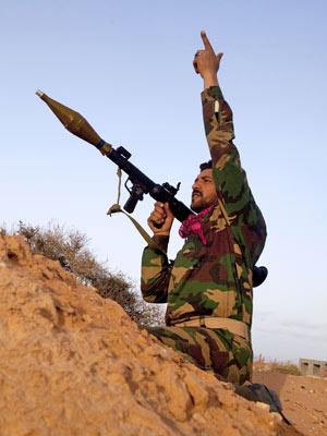 Rebelde na Líbia - Crédito: Foto: Kevin Frayer/AP