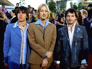 O grupo Silverchair durante uma premiação na Austrália, em 2002 - Crédito: Foto: AFP