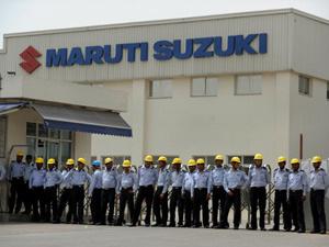 Seguranças indianos protegeram a fábrica da Maruti Suzuki durante a greve  - Crédito: Foto: Manan Vatsyayana/AFP