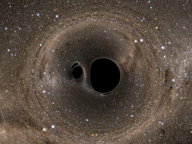 Simulação ilustra colisão de buracos negros como aquela detectada pelo projeto Ligo - Crédito: Foto: Andy Bohn et al.