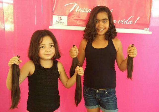 Irmãs Maria Luíza de 7 anos e Ana Clara de 11 anos foram voluntárias. - Crédito: Foto: Divulgação