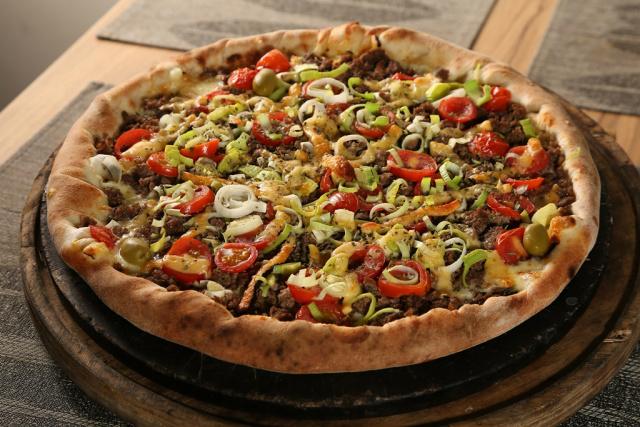 Festival Gastronômico de Dourados tem várias opções de pizzas, incluindo à base de carnes. - Crédito: Foto: A. Frota