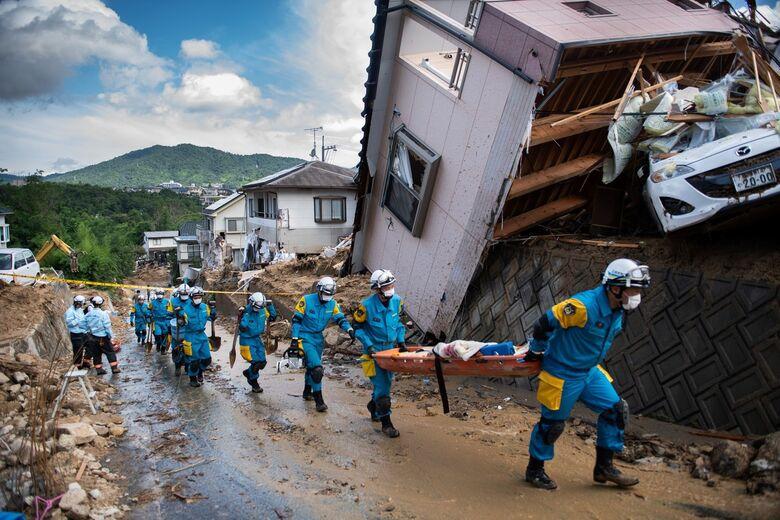 Fortes chuvas já mataram 157 pessoas no Japão - Crédito: Martin Bureau/AFP