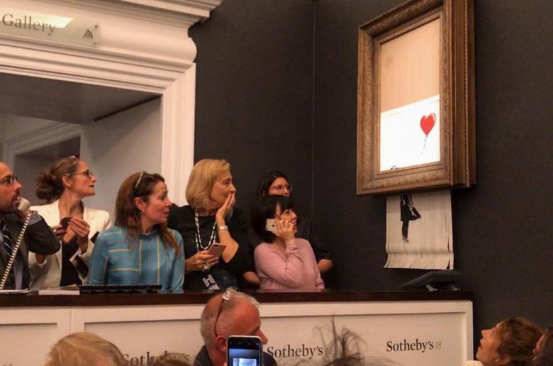 "Pintura de Banksy se ""autodestrói"" após ser vendida por 1 milhão de libras -"